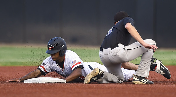 Joplin's Freilen Cabrera slides safely into second base as Chillicothe Mudcats shortstop Logan Eickhoff fields the throw during their game on Tuesday night at Joe Becker Stadium.<br /> Globe | Laurie Sisk