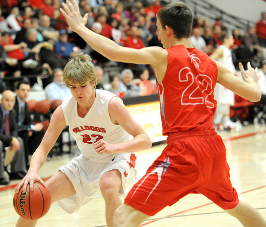 Carl Junction's Braydon Allen (23) tries to get past Webb City's Zach Davidson during their Class 4 District 12 semifinal game on Thursday night at Carl Junction.<br /> Globe | Laurie Sisk