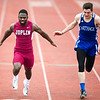 Joplin's Dustin Hunter, left, battles Carthage's xxx in the 100m dash during the Carthage Invitational on Friday at Carthage's K.E. Baker Stadium.<br /> Globe | Laurie Sisk