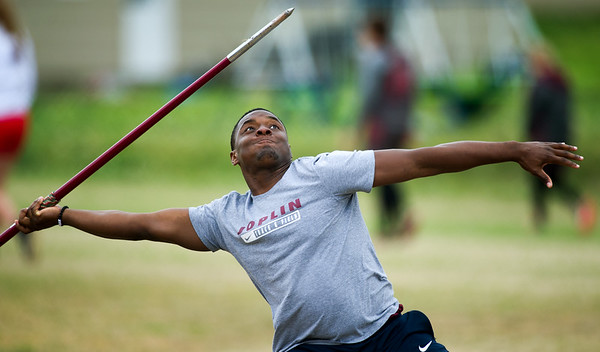 Joplin's Joakem Crawford launches the javelin en route to a school and personal record during the Carthage Invitational on Friday at Carthage.<br /> Globe | Laurie Sisk