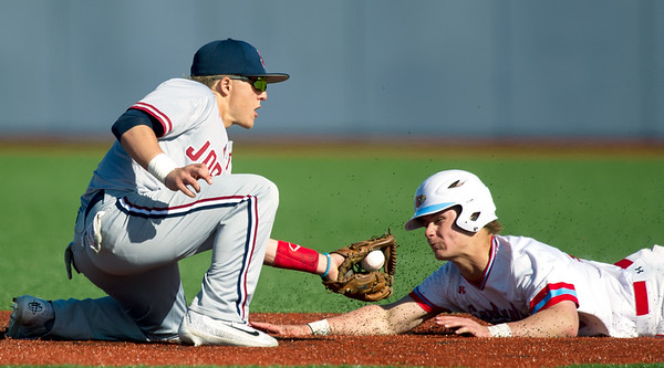 Joplin shortstop Gavin Merriman, left, tags out Webb City's Matt Duley on an attempted steal at second base  during Webb City's game against Joplin on Tuesday at JHS.<br /> Globe | Laurie Sisk