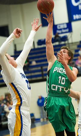 Pierce City's Donell Kleiboeker (10) shoots over Crane's Deven White (23) during their Missouri Class 2 Section 8 game on Thursday night at Carthage High School.<br /> Globe | Laurie Sisk