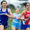 Carthage's xxx xxx battles East Newton's xxx xxx during the anchor leg of the Girls' 4x800 during the Carthage Invitational on Friday at Carthage's K.E. Baker Stadium.<br /> Globe | Laurie Sisk