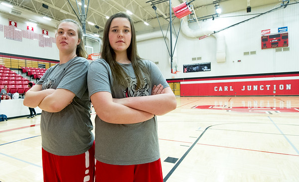 From the left: Twin towers Megan and Kaitlin Scott pose for a photo before practice on Tuesday afternoon at Carl Junction High School. The pair hope to lead their Carl Junction team to a state championship in Columbia this weekend.<br /> Globe | Laurie Sisk