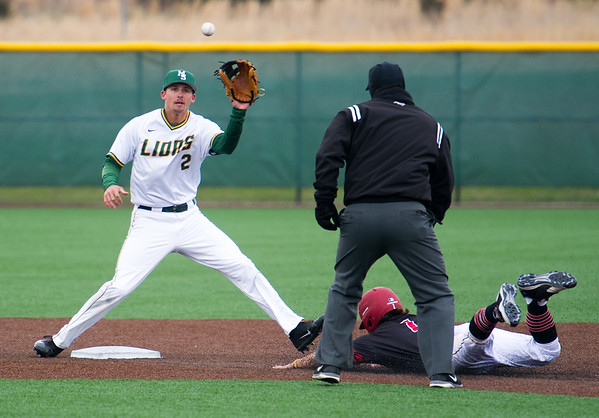 Missouri Southern shortstop Richie Gorski waits for the throw from homeplate as Maryville's Zack ruckmann slides safely into second base on a steal during the second game of the Lions' doubleheader against Maryville University on Tuesday afternoon at Warren Turner Field.<br /> Globe | Laurie Sisk