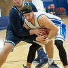 Ozark Christian College's Tanner Moore, left,  battles Rhema Bible College's Tanner Gregurich for a rebound during their semifinl game in the Association of Christian College Athletics National Championship on Friday night at OCC.<br /> Globe | Laurie Sisk
