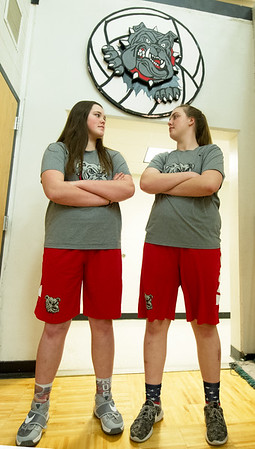 From the left: Twin towers Kaitlyn and Megan Scott pose for a photo before practice on Tuesday afternoon at Carl Junction High School. The pair hope to lead their Carl Junction team to a state championship in Columbia this weekend.<br /> Globe | Laurie Sisk