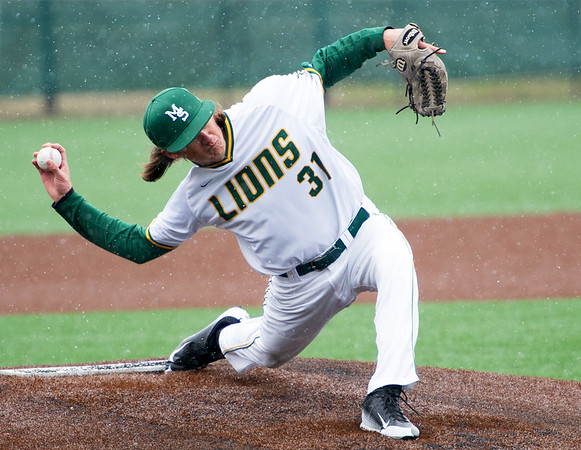 Missouri Southern pitcher Hayden Brauser delivers a pitch to the plate during the first game of the Lions' doubleheader against Maryville University on a snowy Tuesday afternoon at Warren Turner Field.<br /> Globe | Laurie Sisk