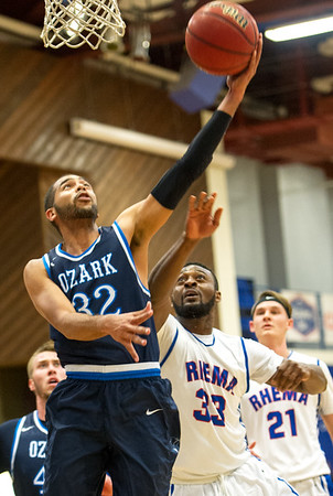 Ozark Christian College's Evan HAnd (32) gets past Rhema Bible College's Tele Adenihum (33) for a rebound during their semifinl game in the Association of Christian College Athletics National Championship on Friday night at OCC.<br /> Globe   Laurie Sisk