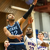 Ozark Christian College's Evan HAnd (32) gets past Rhema Bible College's Tele Adenihum (33) for a rebound during their semifinl game in the Association of Christian College Athletics National Championship on Friday night at OCC.<br /> Globe | Laurie Sisk