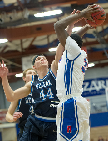 Ozark Christian College's Andrew Mayes (44) defends Rhema Bible College's Tele Adenihum (33) during their semifinl game in the Association of Christian College Athletics National Championship on Friday night at OCC.<br /> Globe | Laurie Sisk