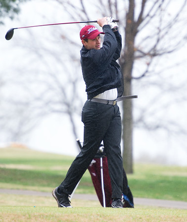 Joplin golfer Alex Ramirez drives from the no. 7 tee on a rainy Thursday at Twin Hills.<br /> Globe | Laurie Sisk