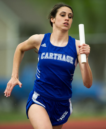 Carthage's xxx carries the baton as the anchor leg of the Girls' 4x200 relay during the Carthage Invitational on Friday at Carthage's K.E. Baker Stadium.<br /> Globe | Laurie Sisk