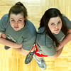 From the left: Twin towers Megan and Kaitlyn  Scott pose for a photo before practice on Tuesday afternoon at Carl Junction High School. The pair hope to lead their Carl Junction team to a state championship in Columbia this weekend.<br /> Globe | Laurie Sisk