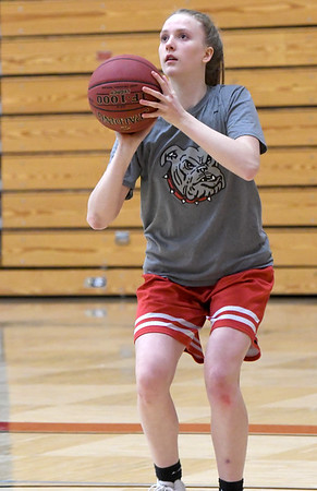 Junior Kenzee Shanks puts up a shot during practice on Wednesday at Carl Junction High School.<br /> Globe | Laurie Sisk