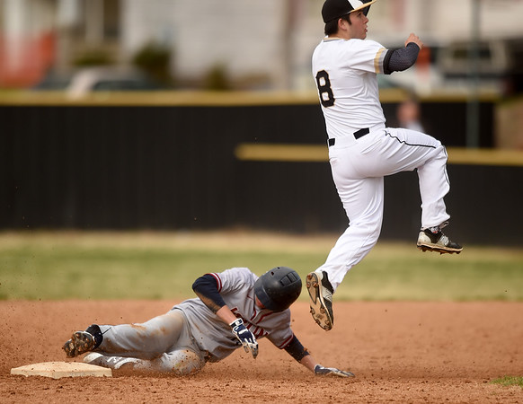 Joplin's Josh Wells slides safely into second base as Neosho infielder Hank Selig leaps to field the throw during their game on Tuesday at NHS.<br /> Globe | Laurie Sisk
