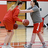 From the left: Sisters Megan and Katie Scott run through ball handling drills during practice on Wednesday at Carl Junction High School.<br /> Globe | Laurie Sisk