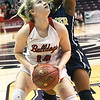 Carl Junction's Taylor Hughes looks to score as Miller Academy's Chaadah Hodges (1) defends during their Class 4 semifinal game on Friday at Missouri State.<br /> Globe | Laurie Sisk