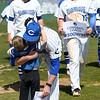 Crowder coach Travis Lallemand gets a post game hug from his three-year-old son, Luc Lallemand after the Roughrider skipper notched his 500th win on Thursday at Crowder.<br /> Globe | Laurie Sisk