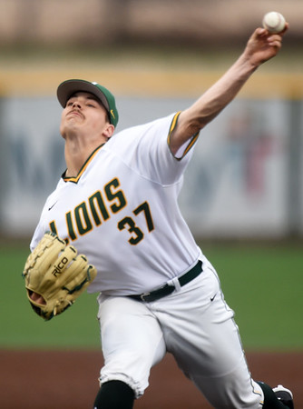 Missouri Southern's Corbin Osburn delivers a pitch to the plate during the Lions game against Emporia State on Friday night at Warren Turner Field.<br /> Globe | Laurie Sisk