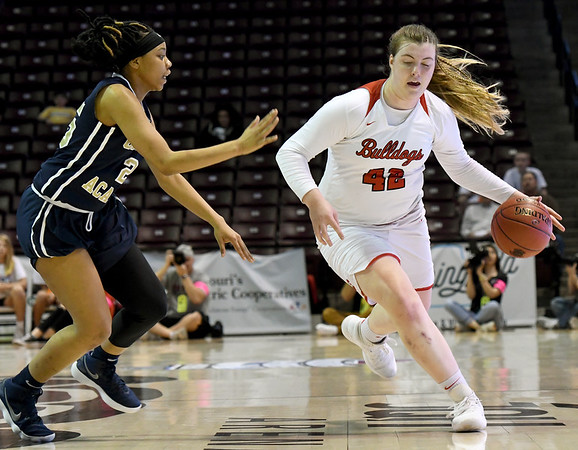 Carl Junction's Megan Scott (42) works to get past Miller Academy's Mauricea Mathis (25) during their Class 4 semifinal game on Friday at Missouri State.<br /> Globe   Laurie Sisk