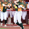 Missouri Southern's Emilee Meyer slaps her way onto first base during the Lions game on Friday at Pittsburg State.<br /> Globe | Laurie Sisk