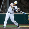 Missouri Southern's Alex Phillips swings for a single during the Lions game against Emporia State on Friday night at Warren Turner Field.<br /> Globe | Laurie Sisk