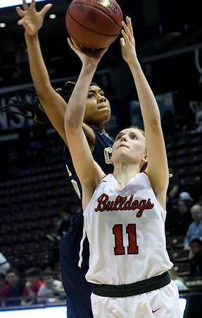 Carl Junction's Kenze Shanks (11) drives the lane as Miller Academy's Mauricea Mathis (25) defends during their Class 4 semifinal game on Friday at Missouri State.<br /> Globe | Laurie Sisk