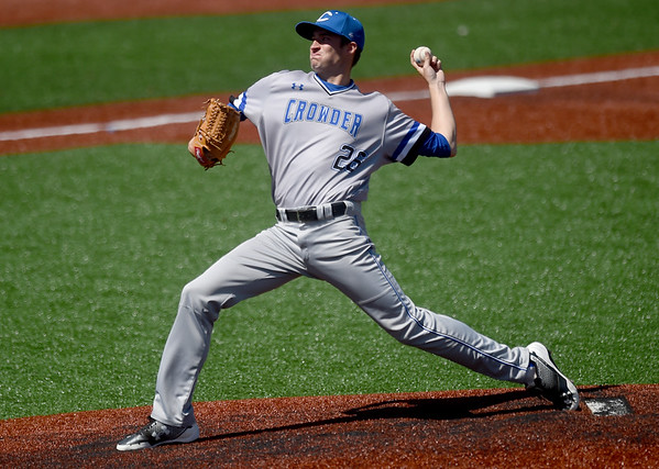 Crowder flamethrower Aaron Ashby delivers a pitch to the plate during the Roughriders game against Mineral Area College on Friday at Joe Becker Stadium.<br /> Globe   Laurie Sisk
