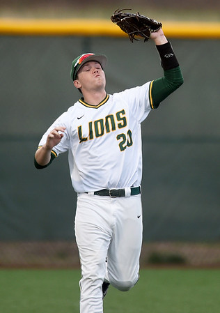 Missouri Southern outfielder Cory Canterbury secures a long fly ball during the Lions game against Emporia State on Friday night at Warren Turner Field.<br /> Globe   Laurie Sisk