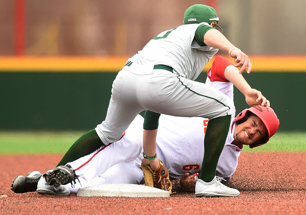 Missouri Southern shortstop Denver Coffee (10) tags Pittsburg State's Colton Pogue (6) for the out during their game on Wednesday at Al Ortolani Field.<br /> Globe   Laurie Sisk