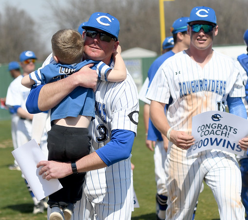 Crowder coach Travis Lallemand gets a post game hug from his three-year-old son, Luc Lallemand after the Roughrider skipper notched his 500th win on Thursday at Crowder.<br /> Globe   Laurie Sisk