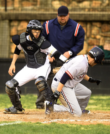 Joplin's Ashton Riley slides safely into home plate as Neosho catcher Alec Marion applies the tag during their game on Tuesday at NHS.<br /> Globe | Laurie Sisk