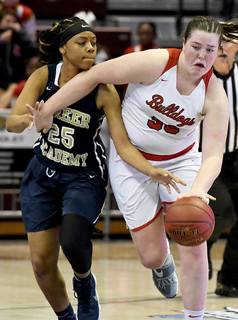 Carl Junction's Katie Scott (33) works to get past Miller Academy's Mauricea Mathis (25) during their Class 4 semifinal game on Friday at Missouri State.<br /> Globe   Laurie Sisk