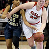 Carl Junction's Katie Scott (33) works to get past Miller Academy's Mauricea Mathis (25) during their Class 4 semifinal game on Friday at Missouri State.<br /> Globe | Laurie Sisk