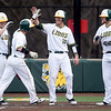Missouri Southern's Johnny Balsamo 9second from the right) is congratulated by teammates (from the left) Cory Canterbury, Denver Coffee and Alex Phillips after a go-ahead 2-run homer during the Lions game against Emporia State on Friday night at Warren Turner Field.<br /> Globe | Laurie Sisk