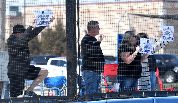 Crowder fans show their appreciation for coach Travis Lallemand after the Roughrider skipper notched his 500th win on Thursday at Crowder.<br /> Globe | Laurie Sisk