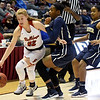 Carl Junction's Kate Dreiling (22) works to get past Miller Academy's Breyanna Howard (11) and Ajanae Garrett (5) during their Class 4 semifinal game on Friday at Missouri State.<br /> Globe | Laurie Sisk