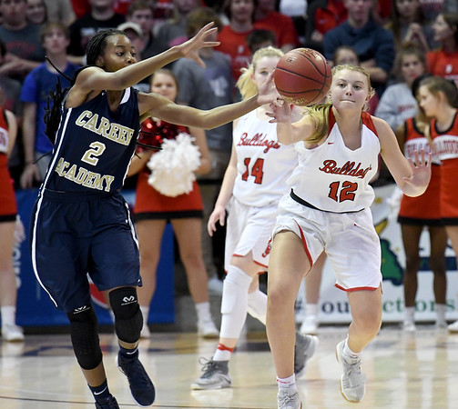 Carl Junction's Shila Winder(12) battles Miller Academy's Daisha Setzer (2) for a loose ball during their Class 4 semifinal game on Friday at Missouri State.<br /> Globe | Laurie Sisk