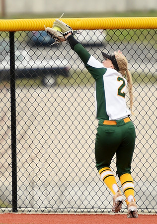 Missouri Southern's Emilee Meyer tracks down a long fly ball to the fence during the seond game of a doubleheader against Fort Hays State on Thursday at Joplin High School.<br /> Globe   Laurie Sisk