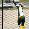 Missouri Southern's Emilee Meyer tracks down a long fly ball to the fence during the seond game of a doubleheader against Fort Hays State on Thursday at Joplin High School.<br /> Globe | Laurie Sisk