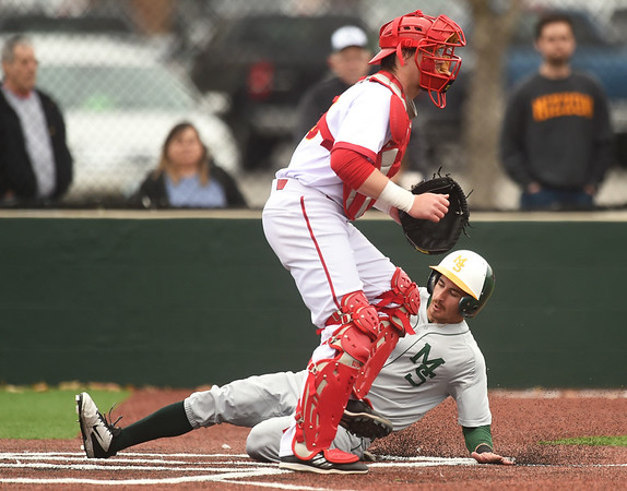 Missouri Southern's Johnny Balsamo slides into home plate for the score as Pittsburg State catcher Josh Whisler awaits the throw during the 5th inning of their game on Wednesday at Al Ortolani Field.<br /> Globe   Laurie SIsk