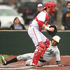 Missouri Southern's Johnny Balsamo slides into home plate for the score as Pittsburg State catcher Josh Whisler awaits the throw during the 5th inning of their game on Wednesday at Al Ortolani Field.<br /> Globe | Laurie SIsk