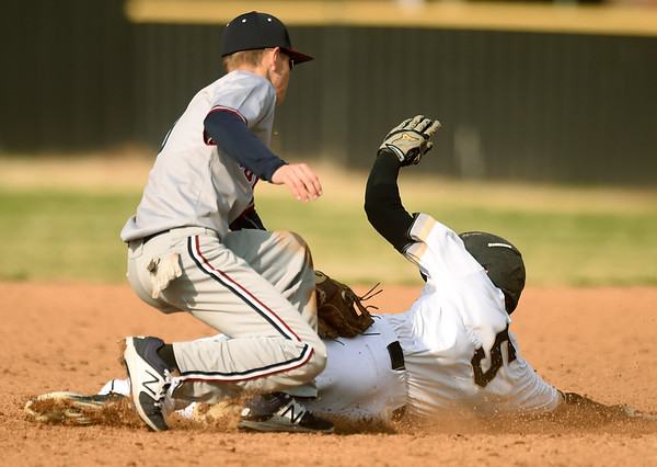 Joplin's Blake Dean gets the tag on Neosho's Gavin Kelley during their game on Tuesday at NHS.<br /> Globe   Laurie Sisk