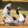 Joplin's Blake Dean gets the tag on Neosho's Gavin Kelley during their game on Tuesday at NHS.<br /> Globe | Laurie Sisk