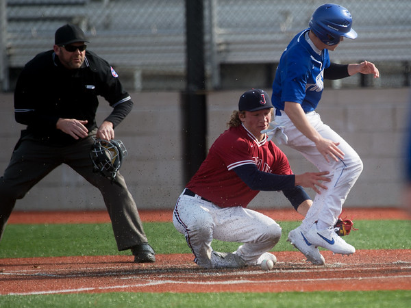 Carthage's Trason Vogt steals home around a tag from Joplin's Zech Stayton during Monday's game at Joplin High School.<br /> Globe | Roger Nomer