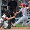 From the left: Carl Junction catcher Noah Southern prepares to tag out Webb City's Treghan Parker (5) during their game on Tuesday at Carl Junction.<br /> Globe | Laurie Sisk