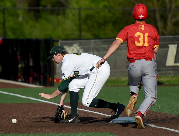 Missouri Southern first baseman Matt Miller (40) scoops a low throw to get the out on Pittsburg State's Tyson Cushman (31) during their game on Friday at Warren Turner Field.<br /> Globe   Laurie Sisk