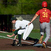 Missouri Southern first baseman Matt Miller (40) scoops a low throw to get the out on Pittsburg State's Tyson Cushman (31) during their game on Friday at Warren Turner Field.<br /> Globe | Laurie Sisk