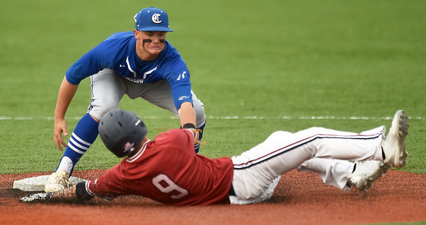 Carthage shortstop Kaden Kralicek tags out Joplin's Blake Dean (9) during their game on Tuesday at JHS.<br /> Globe | Laurie Sisk